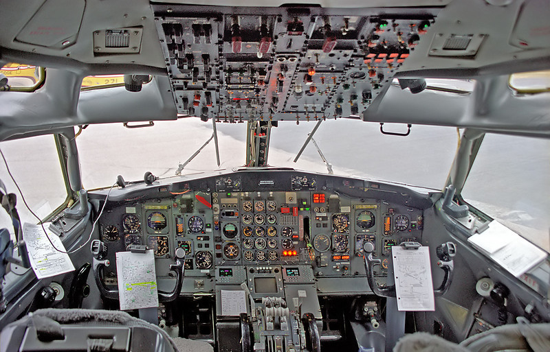 The cockpit of a Boeing 727-233 . I was able to get this shot as the aircraft sat on the ramp for several hours due to a blown tire. I was handling baggage for this MNR charter.<br /> <br /> Film camera used, then the negative scanned with a Nikon Coolscan IV ED.
