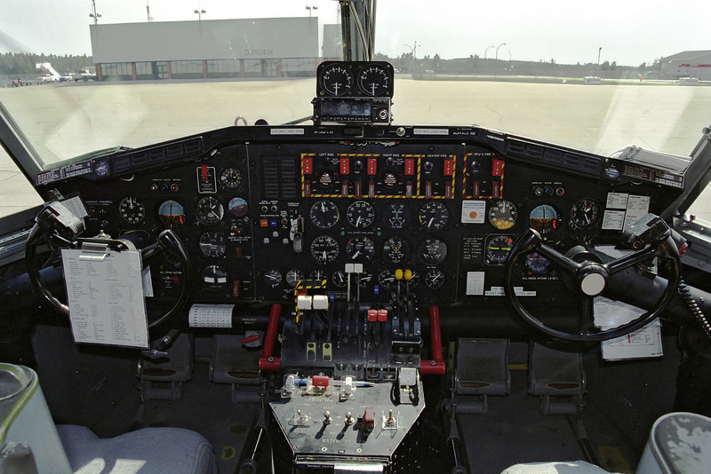 Flight deck of Buffalo 295 (a CL-215) as she sat on the Dryden ramp in June of 2003.<br /> <br /> This negative strip was damaged - the strip was broken during deloping and you can see some evidence of that in the upper left corner.
