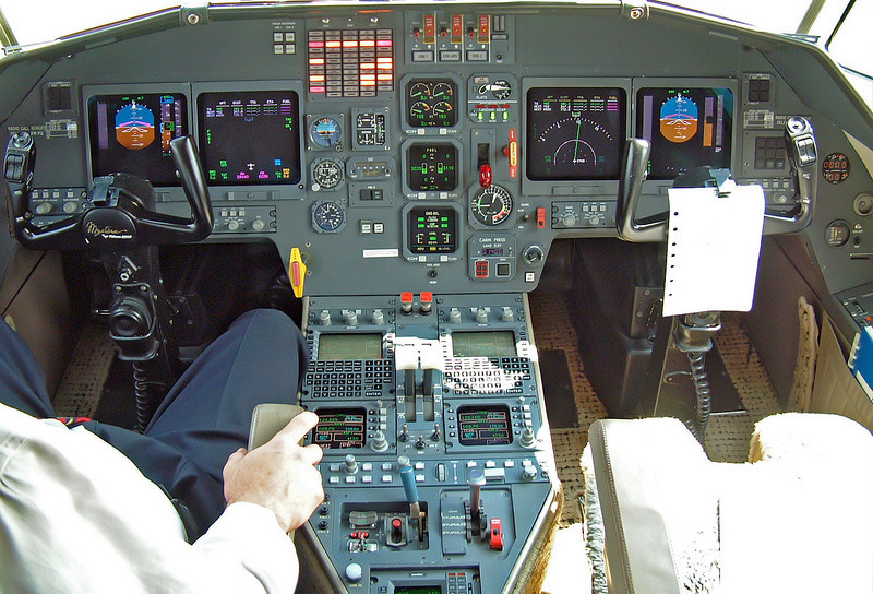 Cockpit of a Falcon 2000, complete with the Captain sitting in the left seat.