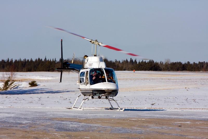 Forest Helicopters has just landed on the Dryden ramp in this Bell 206B.