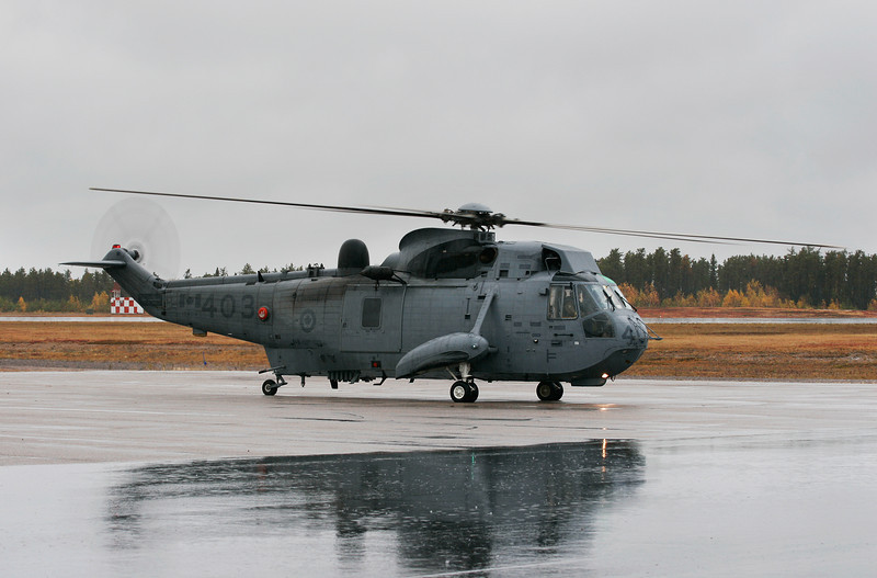 A CH-124 Sea King helicopter. Hard to get a good shot of a gray subject, in the rain, on a gray overcast day. Canon 20D, Canon EF 70-300 IS USM