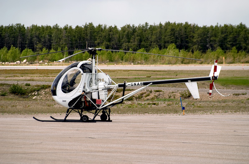 A Schweizer 300C (although when I looked up the registration it came up as a 269C) sits on the Dryden ramp.