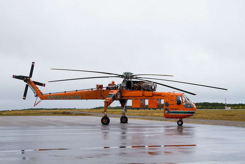 This is so far the only time I've seen a S-64 Air-crane. C-GJRY sitting on the ramp at Dryden shortly before they left. Erickson Air-crane was here for a fuel stop.