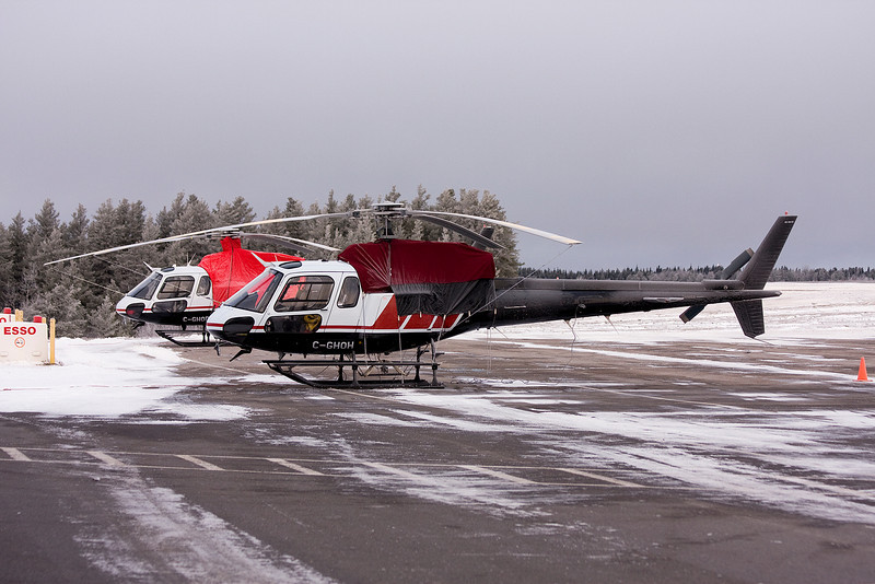 A pair of Aerospatiale AS 350 B-2's sit on the Dryden ramp one frosty morning.