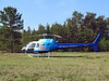 A Aerospatiale AS 350 BA flown by Great Slave Helicopters Ltd sits on the grass down by the Dryden MNR base.
