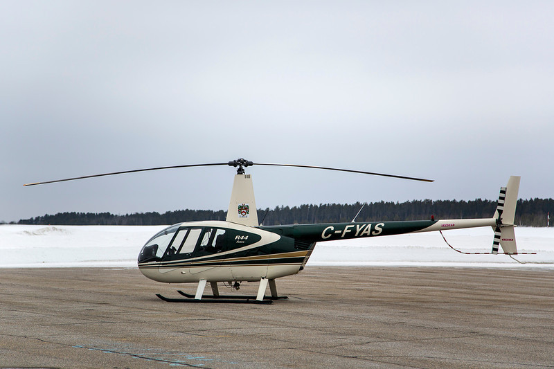 67 of 365 (R44)<br /> <br /> A Robertson R44 sitting on the ramp in Dryden on a overcast day.