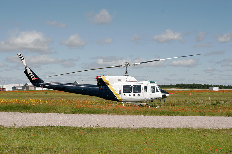 Sequoia Helicopters Ltd sits next to the access road at the Dryden airport. This is a Bell 212.