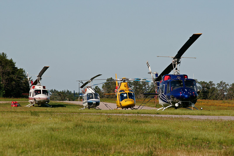 Helicopters waiting to be hired by the MNR to fight fires.