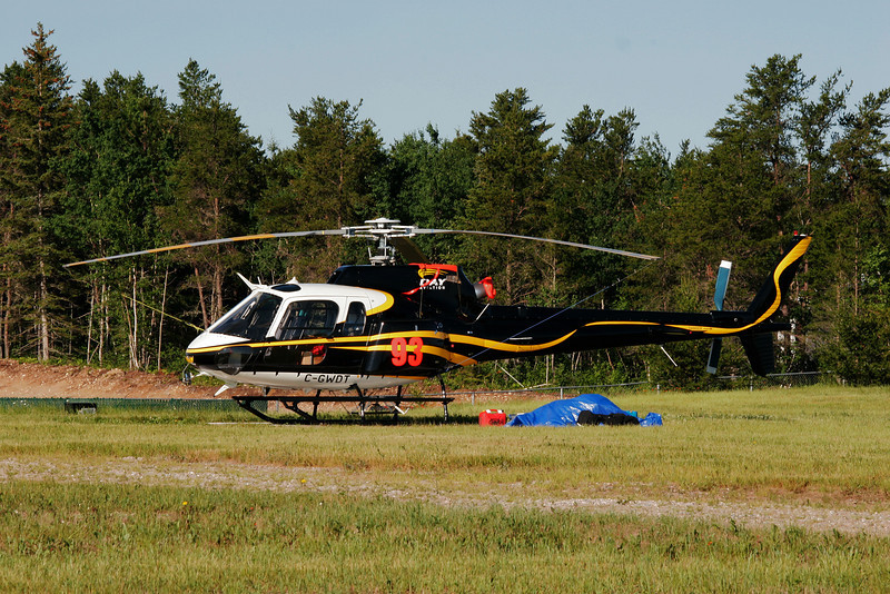Day & Johnston Helicopters Ltd. sitting on a field at the Dryden airport with a Aerospatiale AS 350 B-2.
