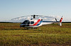 A Aerospatiale AS350B1 from Tulsequah Heliskiing sitting on the field in Dryden wating for a fire dispatch.
