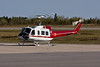 Héli-Transport Inc. (Quebec) getting ready to take off in a Bell 205A-1.