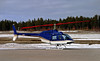 Zimmer Air Services Inc. sits on the Dryden ramp with a Bell 206B.
