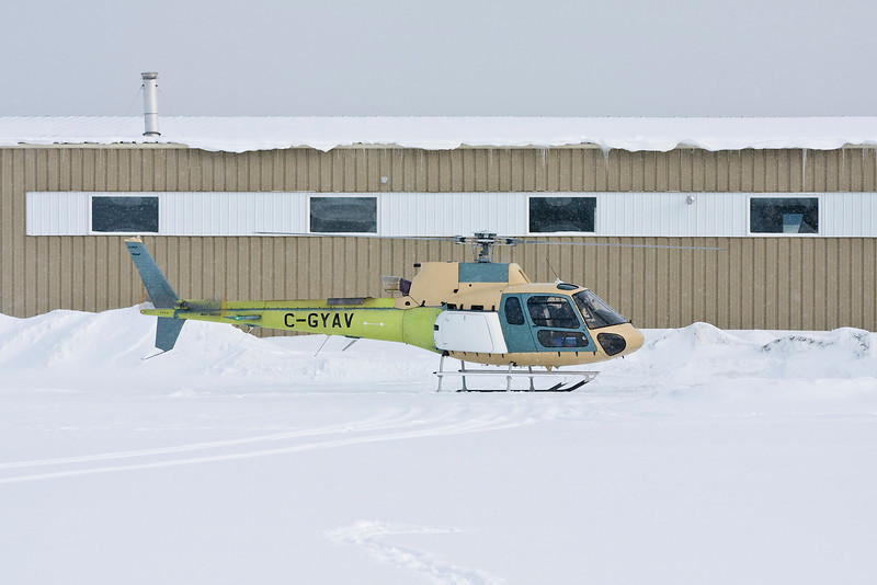 A brand new (registered owner only had it for 3 weeks so far) Aerospatiale AS350 B3 landed to take on fuel at the Dryden airport while it was snowing. As you can see, she has yet to be painted.