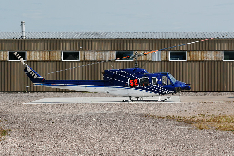 A Bell 212 from Great Slave Helicopters Ltd sits on the pad at the Superior Helicopters hanger at the Dryden Airport.
