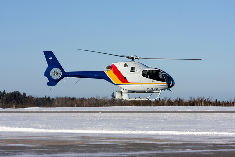 Fresh from the factory, this Eurocopter EC120B (SN 1533) leaves the Dryden airport after taking on some fuel.
