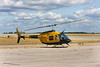 A CH-139 (Bell 206B Jetranger) sits on the Dryden ramp as the crew of this helicopter and a second CH-139 head out for lunch.<br /> <br /> Drydens new runway designator sign in the background - our runways used to be 11-29.