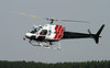 Hydro One coming in for fuel at the Dryden airport in a Aerospatiale AS 350 B-2.