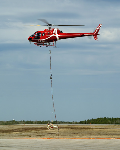 Abitibi stopped in at the Dryden Airport for fuel in this Aerospatiale AS 350 BA while doing some survey work. Here he is lifting off again after being refueled.