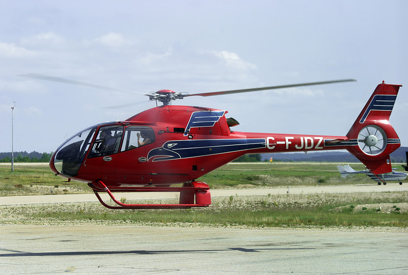 I believe this is a Eurocopter EC120B. Photo was taken in 2003, and through a window. I didn't look up the registration until 2008 so the model may be incorrect.