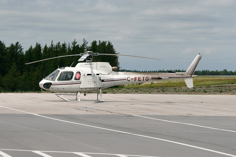 A Aerospatiale AS 350 BA from Panorama Helicopters Ltd. (Quebec) sitting on the ramp at Dryden to be refueled.