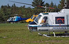 Another Resource helicopter, a Bell 206B waits with two other helicopters for a fire dispatch.