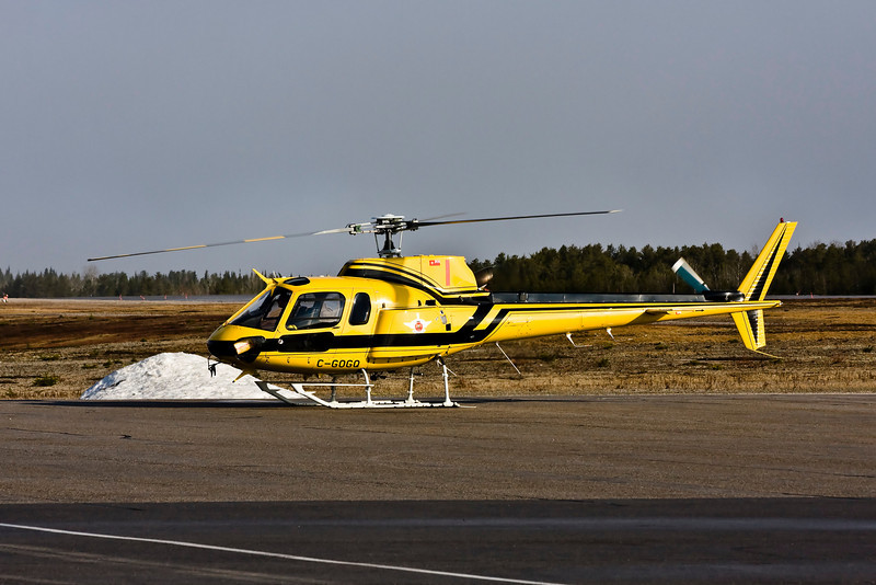 A MNR Aerospatiale AS 350 B-2 lands on the main ramp to get fuel.