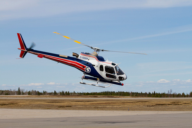 Sander Geophysics leaving Dryden in this Aerospatiale AS350 B3 after refueling.