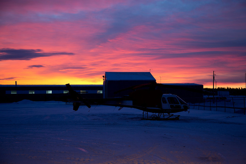 10 of 365<br /> <br /> Sun rising on the morning of January 10th, 2013 with a Geotech Aviation helicopter sitting under wraps at the Dryden airport.<br /> <br /> Also image 10 of 365 of my 365 project.