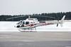 A  Aerospatiale AS 350 B-2 from Kap Central Helicopters Ltd. of Slave Lake Alberta lands on the tarmac looking for fuel.