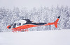 A brand new Aerospatiale AS350 B3E landed in Dryden for fuel while it was snowing. I didn't have much time to get  a better photo as my own flight was coming in so I just had enough time to run for my camera, get this photo, run back to drop off the camera and run back out for my flight.<br /> <br /> And yes, that is snow falling - not digital noise! I was at least 100 meters away when I took this photo so there was lots of snow falling that I had to shoot through.