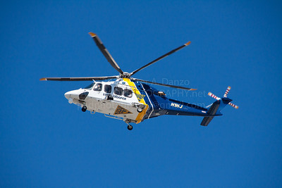 NJSP Helicoptor N1NJ, one of five AugustaWestland AW139's the state police have in service flies over Seaside Park on 9-14-13.