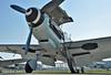 """ILA Berlin at Flughafen Schönefeld (SXF) on September 14, 2012. Messerschmitt Stiftung Messerschmitt Bf 109G-4 D-FWME. Painted as Luftwaffe """"- + 7"""" (Rote Sieben). This aircraft was originally built as a Spanish Hispano HA-1112M-1L Buchõn (cn 139/C.4K-75)."""