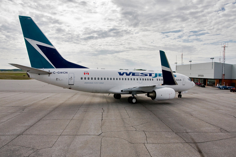 A WestJet 737-700 on the Dryden ramp to pick up MNR forest fire fighters - the first MNR charter of the year.<br /> <br /> To get this photo, I was on top of the stairs we use when a aircraft of this size isn't equiped with any of thier own.