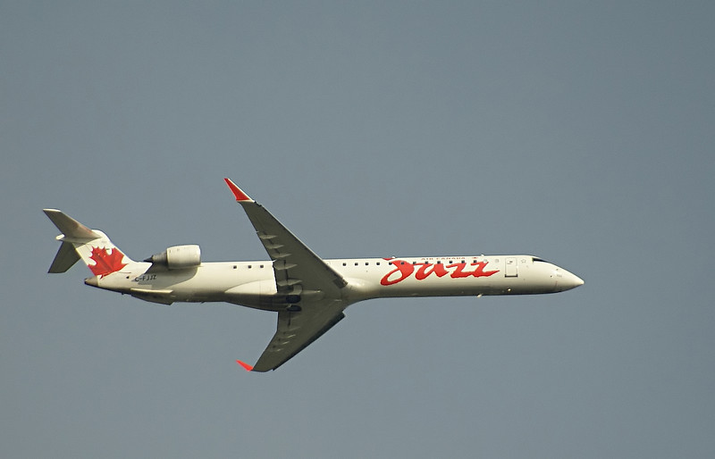 A Jazz Air flight leaves the Winnipeg Aiport in a Bombardier CL-600-2D15. Photo taken through my hotel room window.