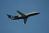 A  Bombardier CL-600-2B19 leaves the Winnipeg Airport. Photo taken through my hotel window.