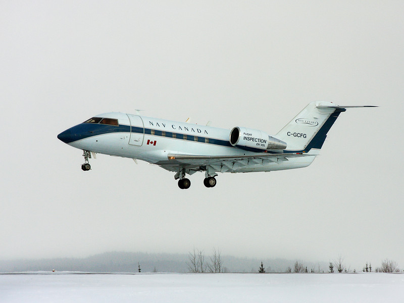 Nav Canada was here this day with a Canadair CL600-2A12, performing some tests on the ILS system. Here they are just taking off to begin the flight testing.<br /> <br /> The day was overcast, and lightly snowing so it wasn't the best day for photos.