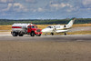 A Cessna 525 sits in front of Hicks & Lawrence in Dryden while the fuel truck operator hunts down the pilot to sign the fuel slip.<br /> <br /> This is a HDR image using Photomatix Pro to combine 3 images.