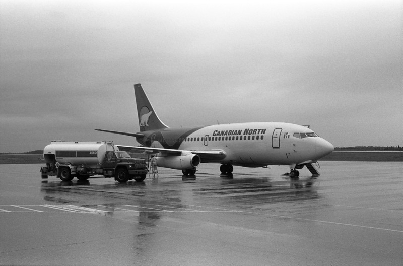 A Canadian North 737-275 sitting on the Dryden ramp re-fueling. <br /> <br /> Leica R4 with Kodak PX 125 developed in Rodinal 1:25. Developing time wasn't recorded but I believe it was for 6 minutes at 20C.