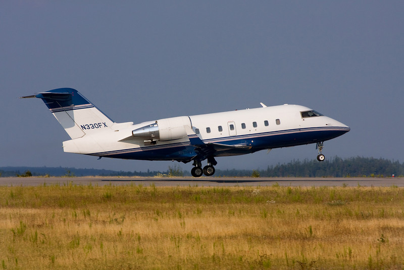 A Bombardier CL-600-2B16 leaves Dryden after dropping off some passengers and refueling.