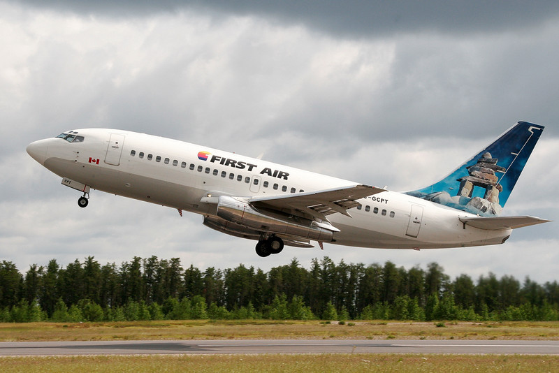 A First Air Boeing 737-217 leaves Dryden with more forest fire fighters.