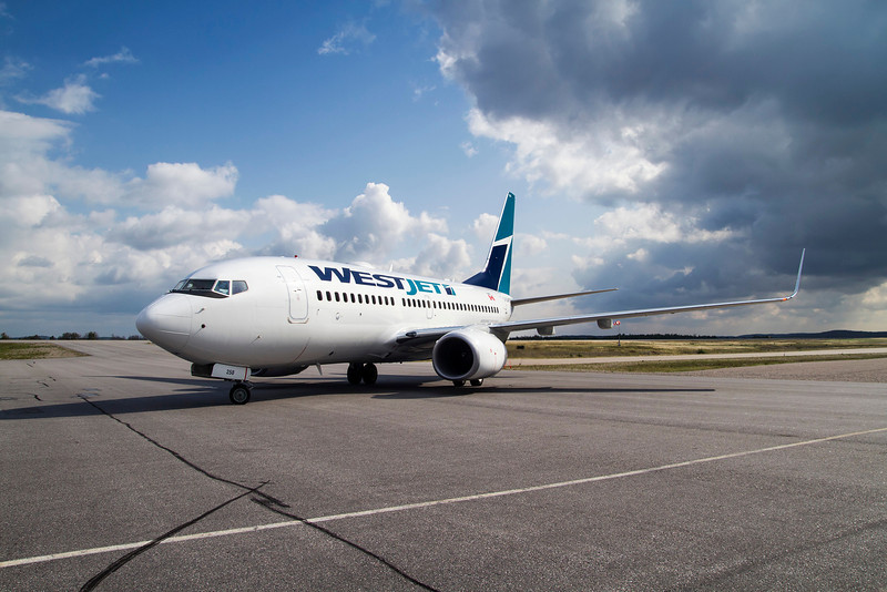 Westjet positioning on the Dryden ramp to pickup some MNR Forest Fire Fighters in this  Boeing 737-7CT.