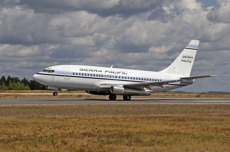 A Sierra Pacific Boeing 737 leaving Dryden  to bring 100 or so forest fire fighters to help fight forest fires in Montanna, USA.<br /> <br /> This plane was in Dryden once before - on June 19th, 1997.