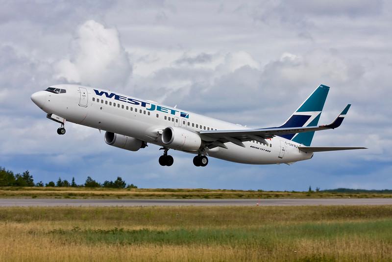 West Jet leaving Dryden in a Boeing 737-800.
