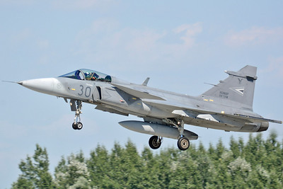 "Hungarian International Airshow & Military Display at kecskemet AB (LHKE) on August 3, 2013. Hungarian Air Force Saab JAS-39C Gripen ""30"" (cn 39301)."