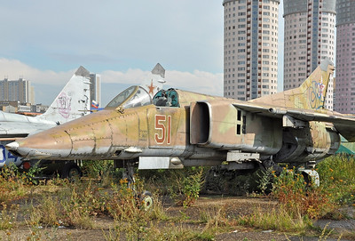 "Former National Air & Space Museum at Khodynka Field in Moscow on August 11, 2012. Soviet Air Force MiG-27 Flogger ""51 Red"" (cn 61912538152). I think ""51 Red"" is an early experimental version of this ground attack aircraft."