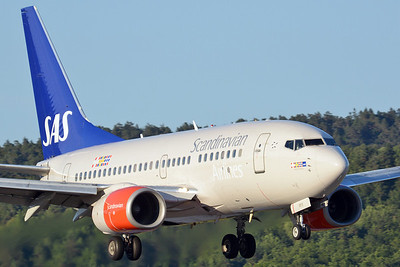 "Kristiansand Airport Kjevik (KRS) on July 5, 2013. SAS Boeing 737-683 LN-RPX (cn 28317/500). ""Scandinavian 223"" makes a evening arrival from Oslo."