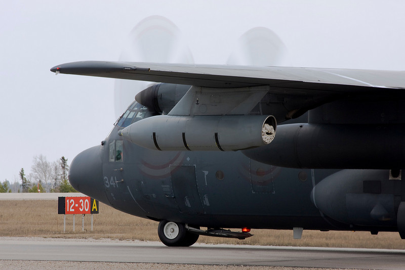 A Hercules waits for clearance to enter the runway at the Dryden airport.