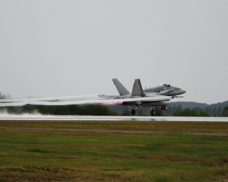 This CF-18 left on a very lousy, rainy overcast day. Originally I wanted to see if I could catch a bit of a rooster tail but saw the vapour trails from the wings and decided to capture that instead.