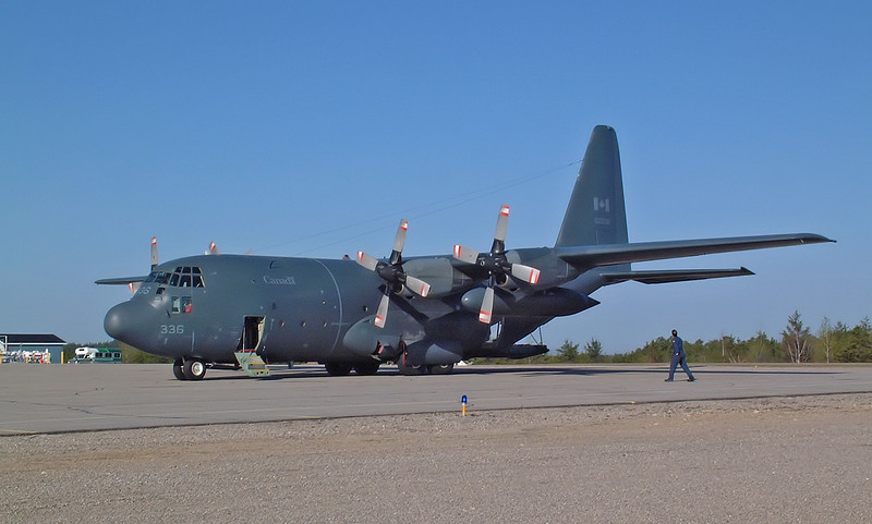Occasionally the Canadian Forces land in Dryden. This is a C-130.<br /> <br /> Normally I don't like people in shots like this, but the crew person here gives us an idea on the size of the aircraft.