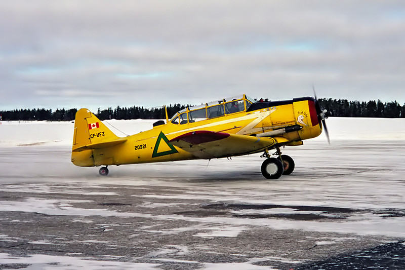 A Harvard 4 (Serial No CCF4 112), built in 1952, came to Dryden for fuel.<br /> <br /> Photo taken with a Leica M5 film camera (made between 1971 and 1975). This photo was also from  the first roll of film that I've put in that camera (2005?). <br /> <br /> Usually I try to have a digital camera at work at all times but on this day I only had the M5. Negative scanned with a Nikon Coolscan IV ED.
